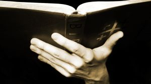 162055_holding_the_bible