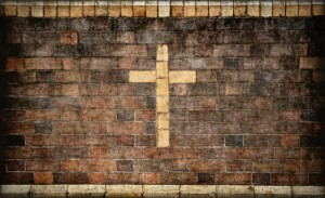 christian cross in brick wall